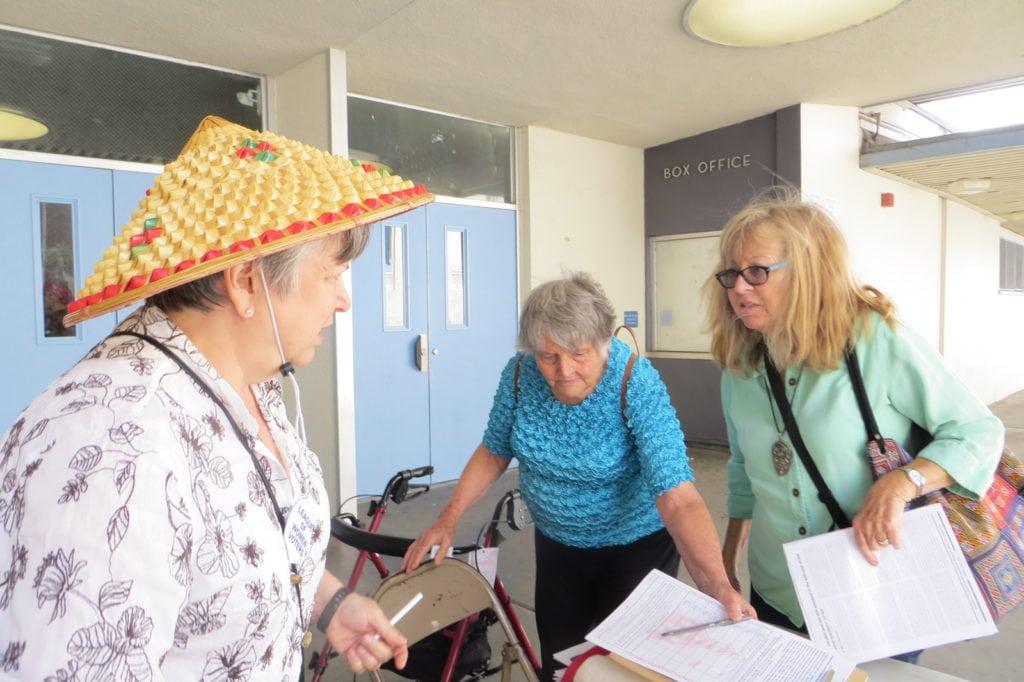 Maggie Goodman (l) getting Reform Prop. 13 petition signatures