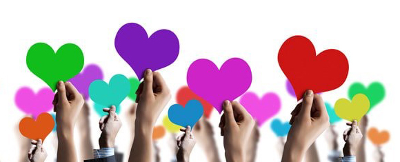 Hands raising heart shapes of different colors