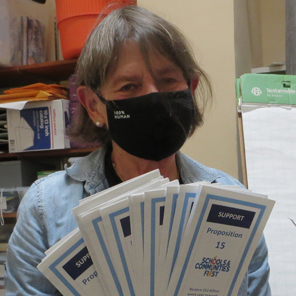 Suzanne Chun with prop15 brochures
